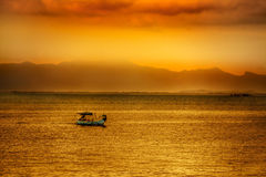 Asian sunset over water Royalty Free Stock Images