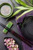 Asian sushi chopsticks, rose tea and teapot Royalty Free Stock Images