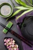 Asian sushi chopsticks, rose tea and teapot Royalty Free Stock Images