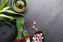 Asian sushi chopsticks, rose tea and teapot Stock Photography