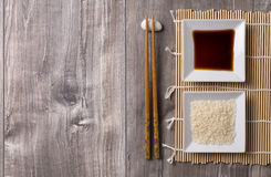 Asian table with chopsticks, rice and soy sauce Royalty Free Stock Photo