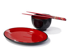Asian tableware. Asian melamine tableware in red and black isolated over white background Stock Images