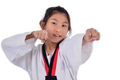 Asian taekwondo girl on with background. Royalty Free Stock Image