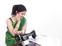 Asian tailor her cell phone Stock Image