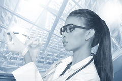 Asian Tan Skin Woman Doctor glasses in White Shirt suit with ste. Thoscope on neck, hold syringe needle injection pull out from medicine tube, copy space for Royalty Free Stock Image