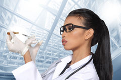 Asian Tan Skin Woman Doctor glasses in White Shirt suit with ste. Thoscope on neck, hold syringe needle injection pull out from medicine tube, copy space for Stock Photo