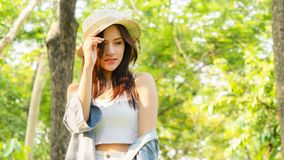 Asian tanned beautiful and fashion girl and hat smiles, in royalty free stock image