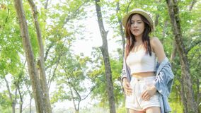 Asian tanned beautiful and fashion girl and hat smiles, in stock photos