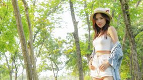 Asian tanned beautiful and fashion girl and hat smiles, in stock photography