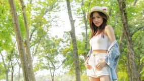 Asian tanned beautiful and fashion girl and hat smiles, in stock photo