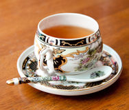 Asian tea. Black tea in an ornate china cup Stock Image