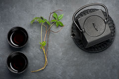 Asian tea in a black cast-iron teapot and cups. Asian style Stock Images