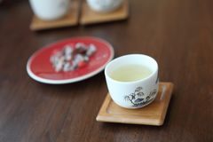 Asian tea cups. On wooden plate stock photos