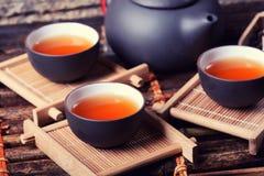 Asian tea. Set on bamboo background Royalty Free Stock Image