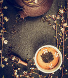 Asian tea set with Iron Teapot and jasmine blossom on vintage rustic background, top view Royalty Free Stock Images