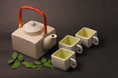 Asian tea set. Served on a black table cloth Stock Images