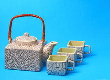 Asian tea set. Served on a blue table cloth Royalty Free Stock Image