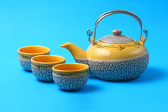 Asian tea set. Served on a blue table cloth Stock Image