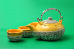 Asian tea set. Served on a green background Royalty Free Stock Image