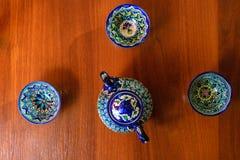 Asian tea set on wooden table. Khiva, Uzbekistan. Closeup. Stock Photos