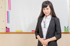 Asian teacher in front of whiteboard Royalty Free Stock Photo