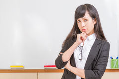 Asian teacher in front of whiteboard Stock Photo