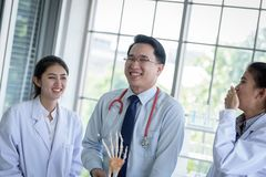 Asian teacher has teaching to student about science and anatomical in laboratory. Anatomy, background, biology, black, body, bone, brain, care, class stock images