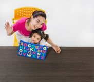 Asian teacher play Alphabet puzzle with students stock images