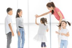 Asian teacher play girls and boy some acting royalty free stock photos