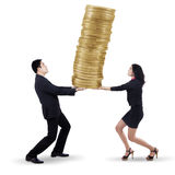 Asian teamwork carrying gold coins 1 Stock Images