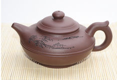 Asian teapot. On the mat Stock Photos