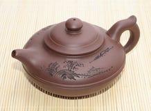 Asian teapot. On the mat Royalty Free Stock Photos