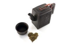 Asian teapot cup and fresh tea Stock Images