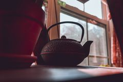 Asian teapot on the table in the kitchen royalty free stock photography