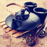Asian teapot and two cups Stock Photo