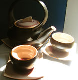 Asian teaset. In the sun stock images