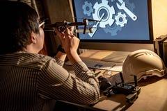 Asian technical engineer checking drone gimbal camera stock image