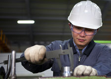 Asian technician at tool workshop Royalty Free Stock Image