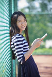 Asian teen age and computer tablet in hand. Asian teen age and    computer  tablet in hand Royalty Free Stock Images