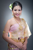 Asian teen age female with traditional Thai suit in Studio. On gray background Royalty Free Stock Images