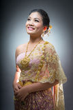 Asian teen age female with traditional Thai suit in Studio. On gray background Royalty Free Stock Image
