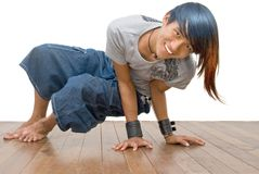 Asian teen emo break dancer. Asian active teenager in a break dancer pose, cheering and smiling, and with punk one-sided colored long hair. Emo and friendly royalty free stock photography