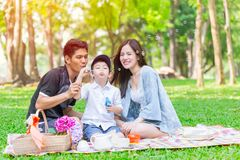 Asian teen family happy holiday picnic. Moment in the park Royalty Free Stock Image