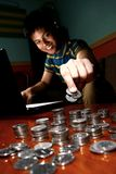 Asian Teen in front of laptop computer and piling on a stack of coins Stock Photo
