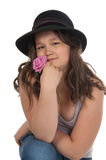 Asian teen girl in black hat. Asian teen girl at the age of twelve in black hat holding a pink rose on white background Stock Images