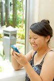 Asian teen girl texting Royalty Free Stock Photo