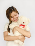 Asian teen holding a  bear doll. Royalty Free Stock Photography