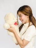 Asian teen holding a  bear doll. Stock Photography