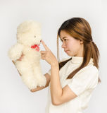 Asian teen holding a  bear doll. Stock Images