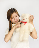 Asian teen holding a  bear doll. Royalty Free Stock Photo